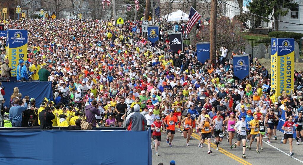 Runners start the 117th running of the Boston Marathon, in Hopkinton, Mass., Monday, April 15, 2013. (AP Photo/Stew Milne)
