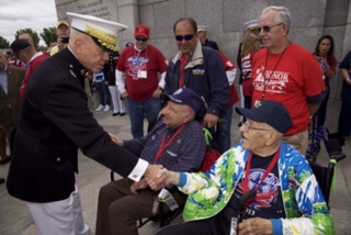 The 35th Commandant of the Marine Corps, Gen. James F. Amos, left, meets with World War II veterans during the Honor Flight event at the World War II Memorial  in Washington, D.C., Sept. 28, 2013. The Honor Flight Network, founded in 2005, flies WWII veterans free of charge to the Washington, D.C. memorial. (U.S. Marine Corps photo by Sgt. Mallory S. VanderSchans/Released)