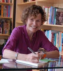 Judy Blume signs one of her books.