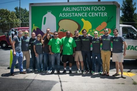 Volunteers and workers pose in front of the AFAC truck.