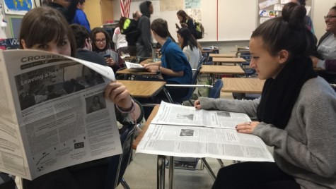 Junior Grace Leckey and senior Rachel Carlson read the Crossed Sabres in class.