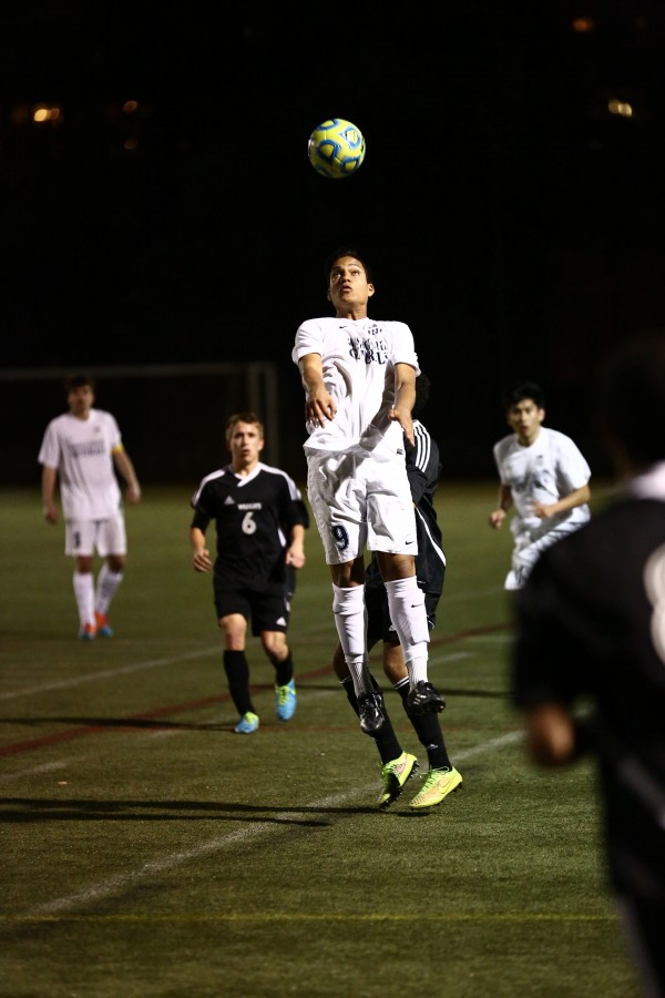 Junior Alejandro Maldonado-Romero heads the ball during a W-L soccer game.
