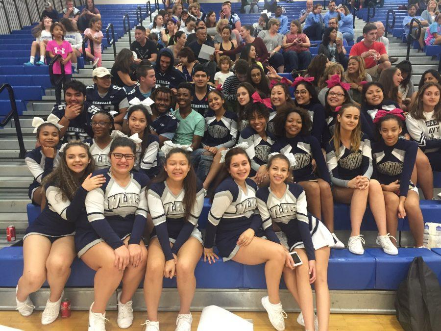 Varsity+football+players%2C+along+with+freshmen+and+JV+cheerleaders%2C+support+varsity+cheer+at+Finals%2C+which+took+place+at+South+Lakes.+