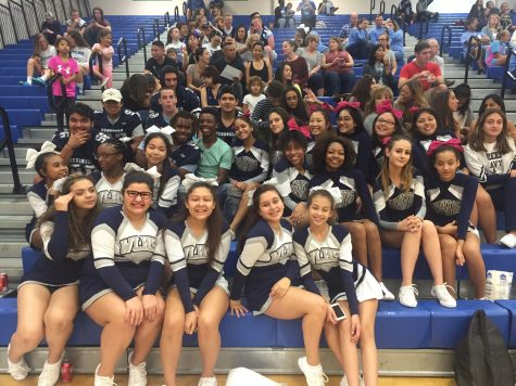 Varsity football players, along with freshmen and JV cheerleaders support varsity cheer at Finals which took place at South Lakes.