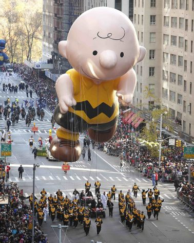 A Charlie Brown float hovers over Macy's Thanksgiving Day Parade onlookers in New York, New York in 2012. Charlie Brown has become one of the few faces of Thanksgiving due to A Charlie Brown Thanksgiving.
