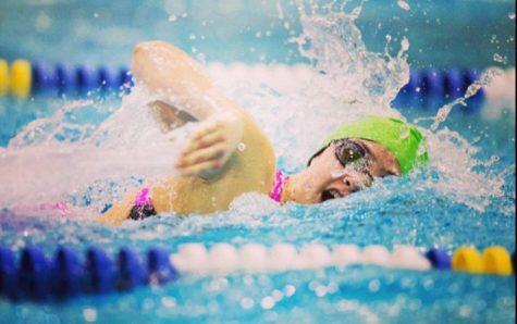 Senior Ellie Ridgeway swims freestyle at an AAC swim meet in 2015.