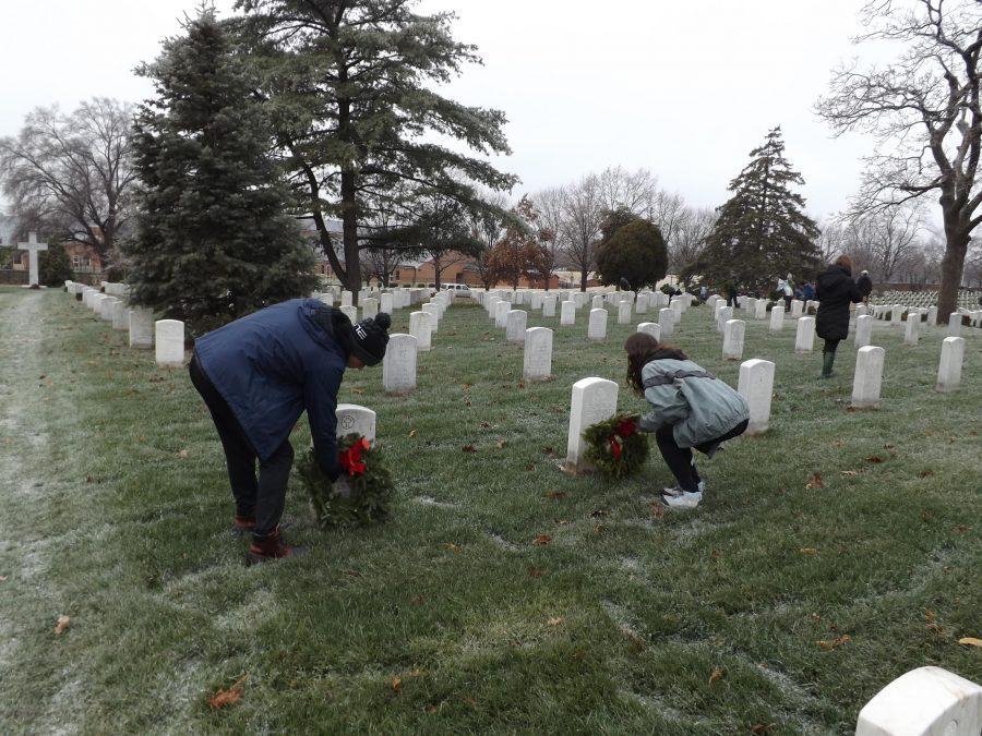 Seniors Claire Huggins and Ethan Hall lay wreaths at Arlington National Cemetery.