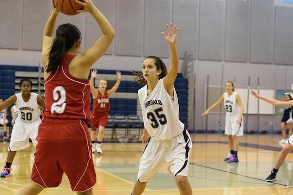 JV girls basketball demonstrates defensive tactics.