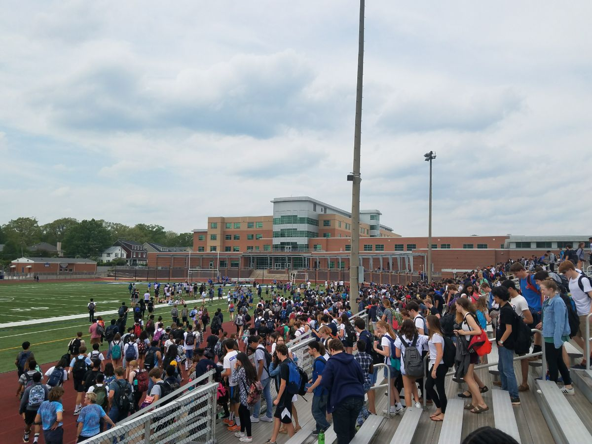 Students exit the bleachers after seniors win the SCA Olympics.