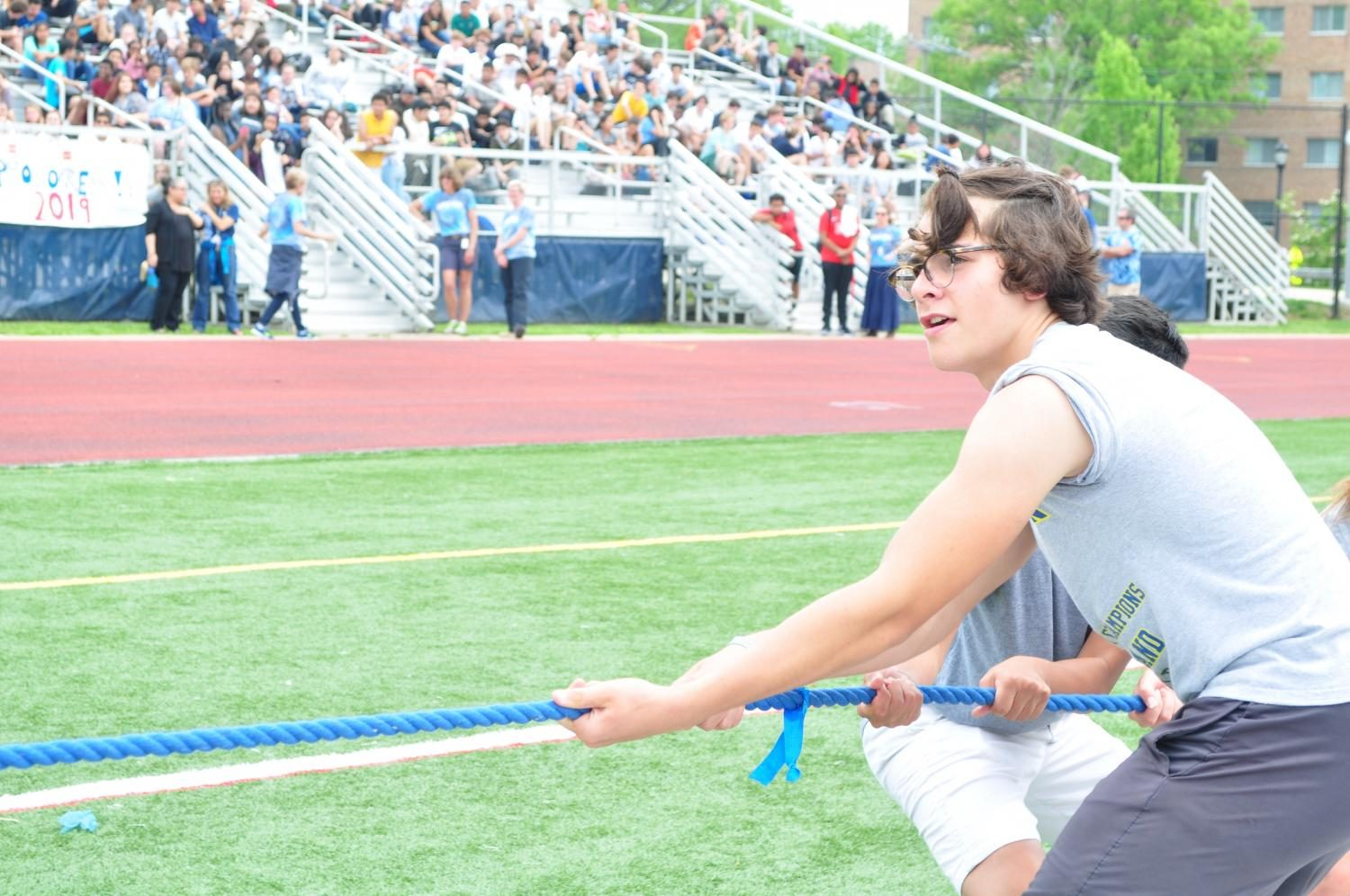 Freshman Noah Toth tries to edge the seniors out for a win in the tug-of-war event.