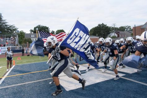 The varsity football team rushes the field at the fall pep rally. The team hopes to continue that success into the coming fall season with the addition of new players.