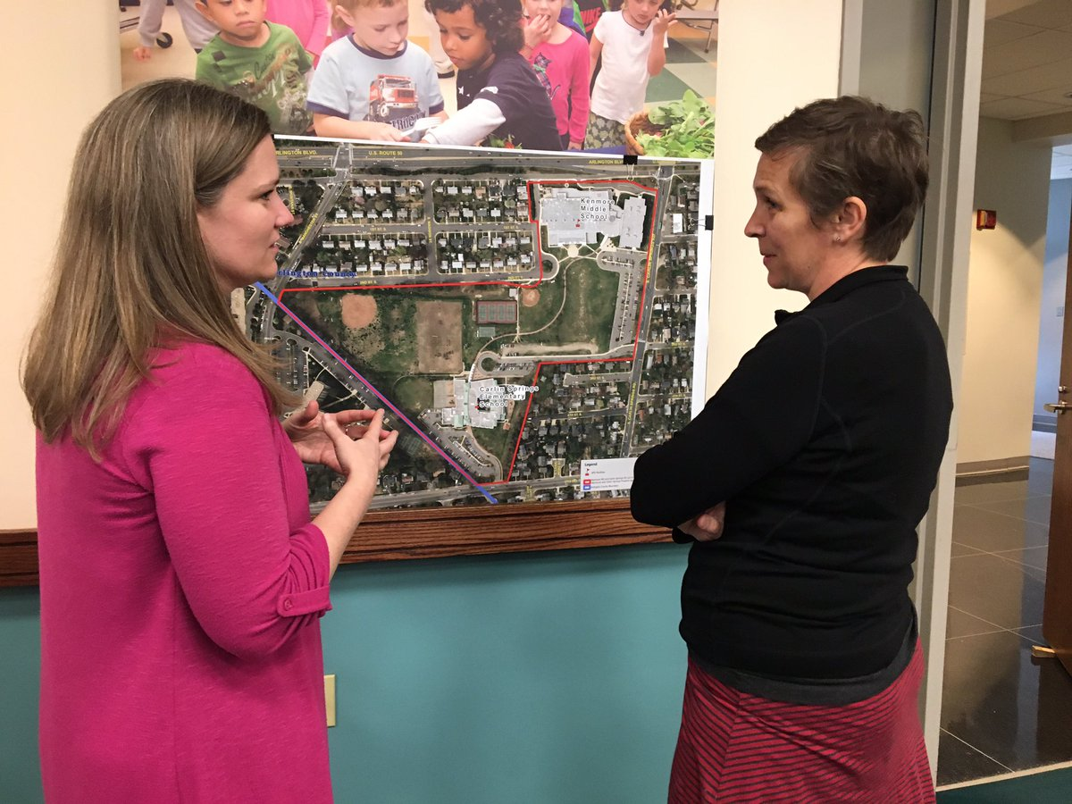 Assistant Superintendent of Instruction Dr. Tara Nattrass discusses one of Arlington Public School's expansion plans with a parent.