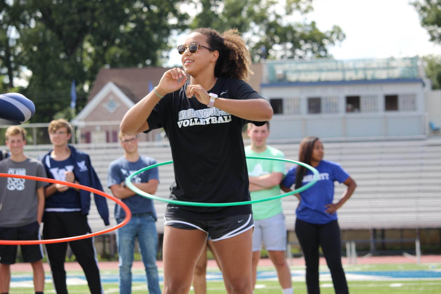Senior Leonie Adler competes in the hula hoop competition for the school's varsity volleyball team.