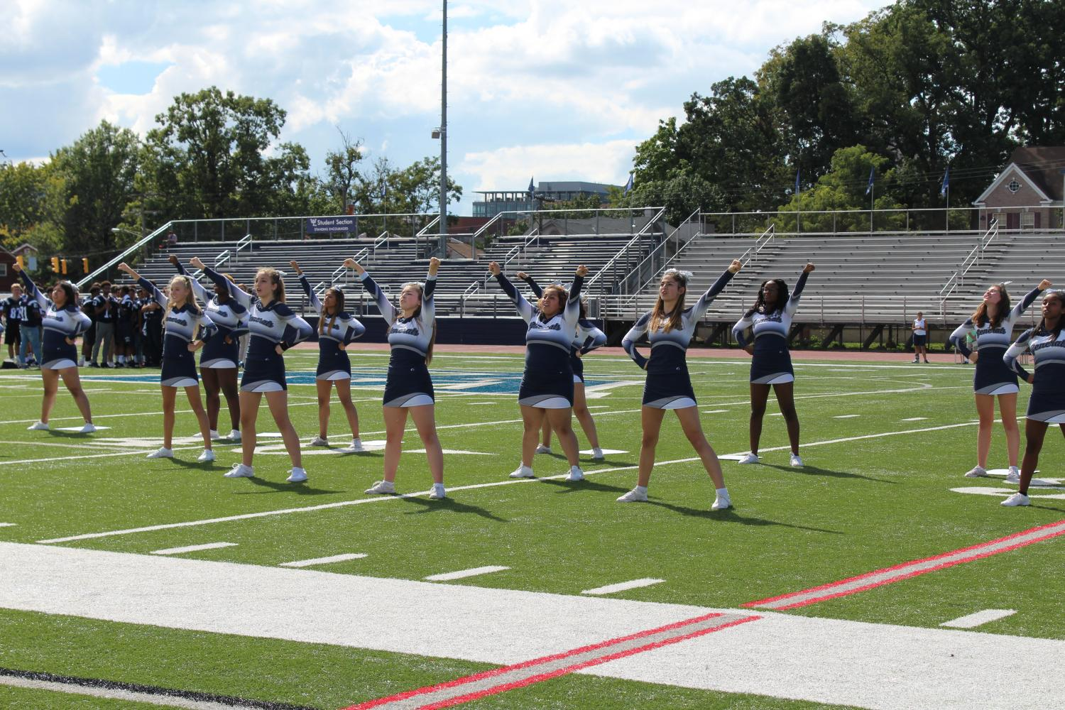 The varsity cheer team do a routine for the crowd at the pep rally