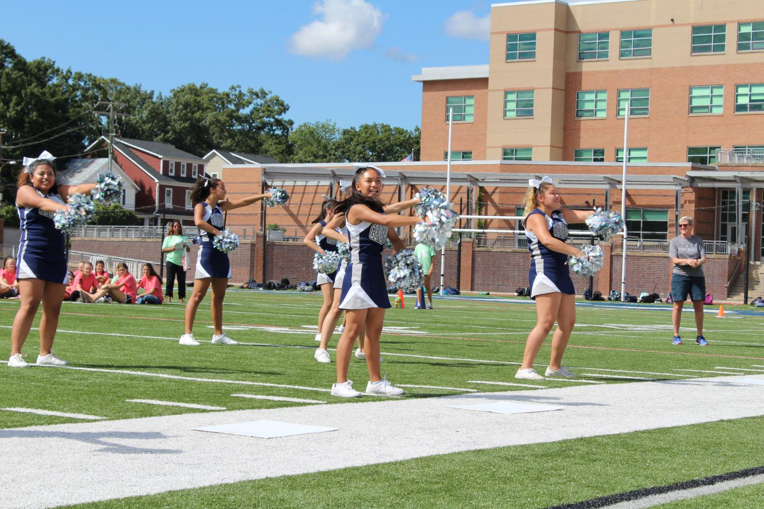 The JV cheer team performs a routine for the crowd at the pep rally