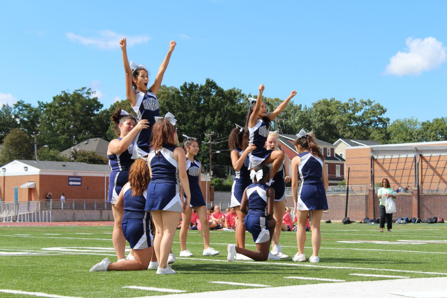 The JV cheer team gets ready to lift two of their members