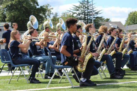 The trumpet players and saxophone players of the marching band are featured in the last song of the pep rally