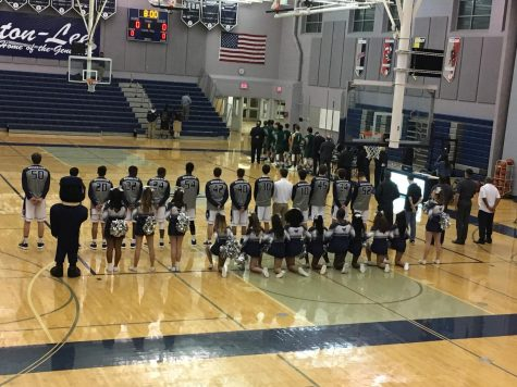 Strong start leads boys basketball to opening night victory