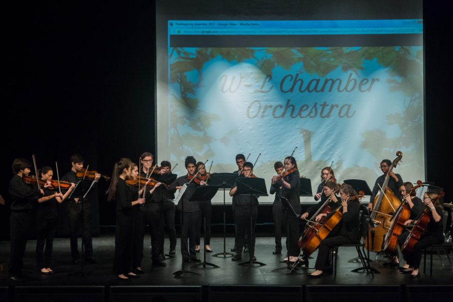 Members of the chamber orchestra perform at this years Thanksgiving assembly. The annual performance is organized by the Student Council Association (SCA).