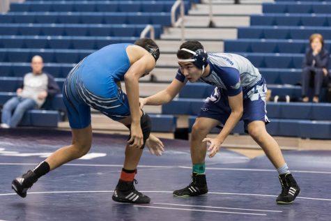 Senior Temmulen Jargalsaikhan focuses on pinning his opponent
