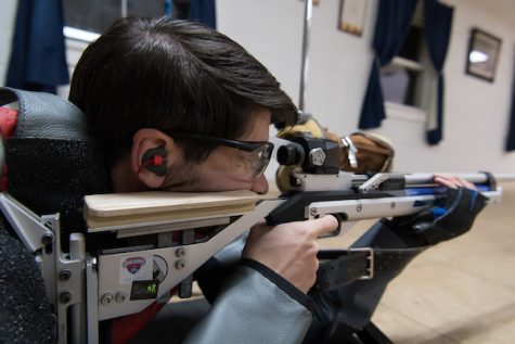 The rifle team has been working hard all year,  perfecting their shots. Senior Aaron Tinter takes aim for a target during practice.