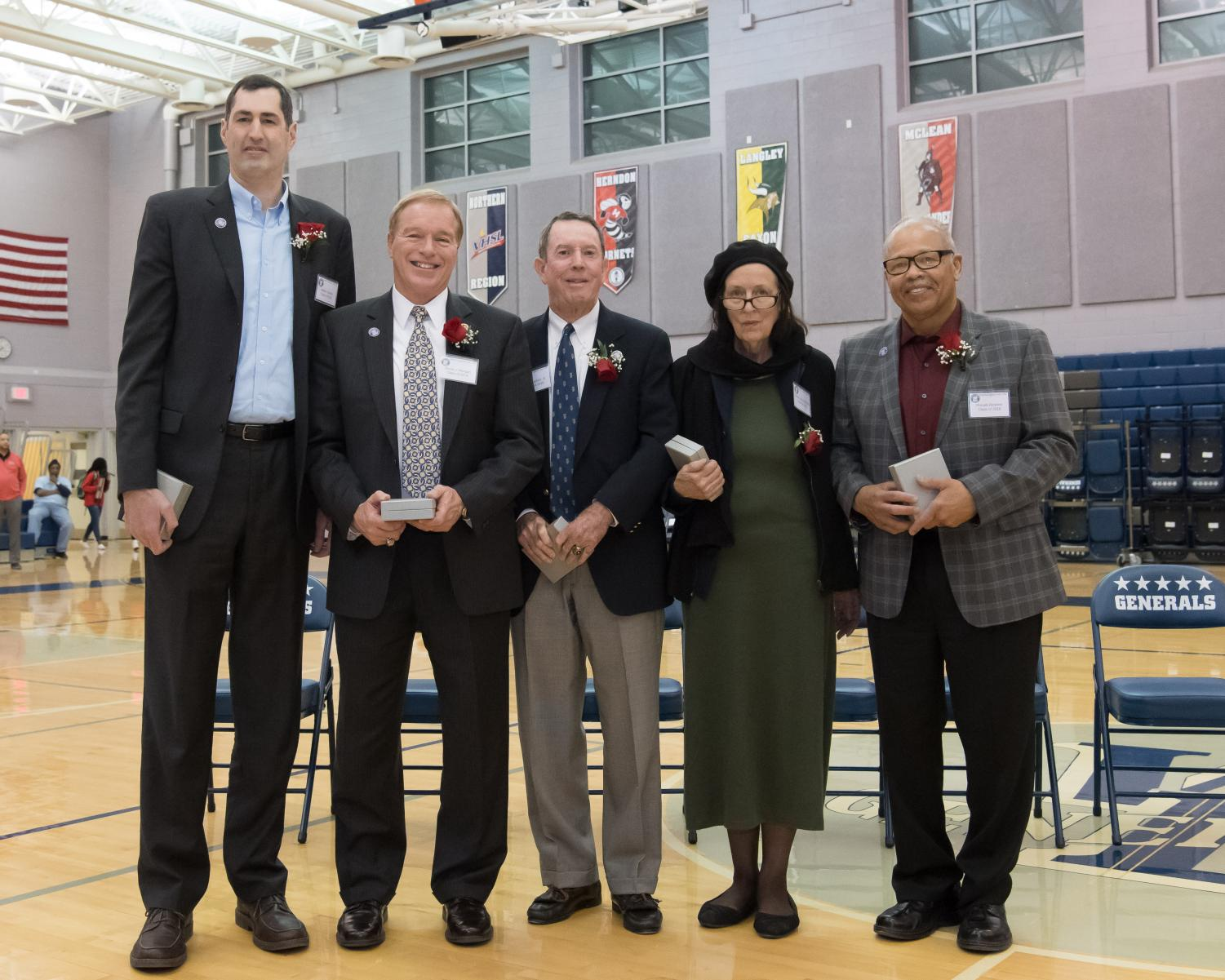 The inductees were honored during in between the girls' and boys' varsity basketball games on Friday, January 19.