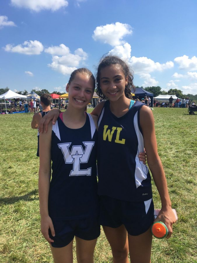 Sophomore+Jeanie+Laybourn+%28on+the+left%29+smiles+beside+her+friend%2C+sophomore+Giulia+Messa%2C+after+finishing+a+cross+country+race.+Although+she+didn%27t+meet+her+goal+time+last+year%2C+her+New+Years+resolution+is+to+continue+to+push+herself+when+it+comes+to+her+running.
