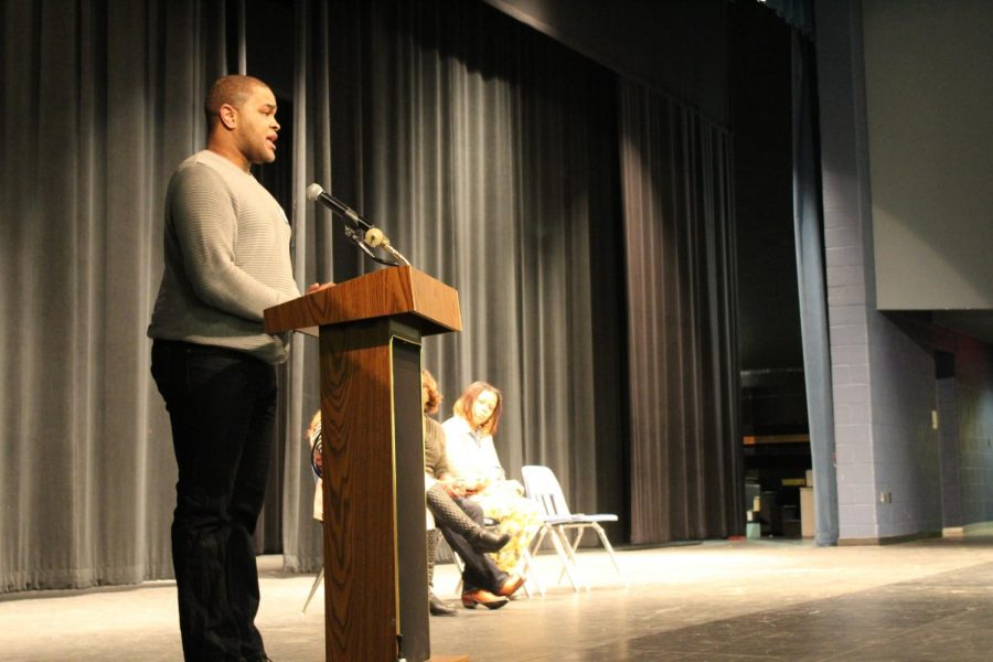 C. Thomas reads his poetry to students during the African American read in.