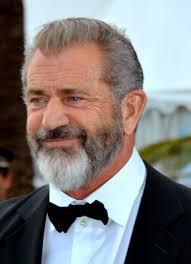 Mel Gibson smiles in a recent red carpet appearance.
