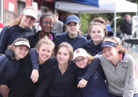 The 2017 girl's crew team poses for a picture at the team docks in Georgetown.
