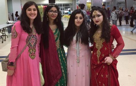 International Club's co-president Sabbah Mughal and past members pose at last year's International Night event.