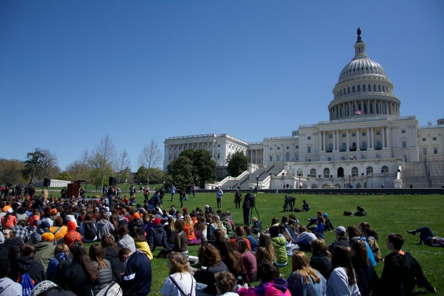 Students gather at the Capitol Building to watch a host of student speakers talk about gun control.