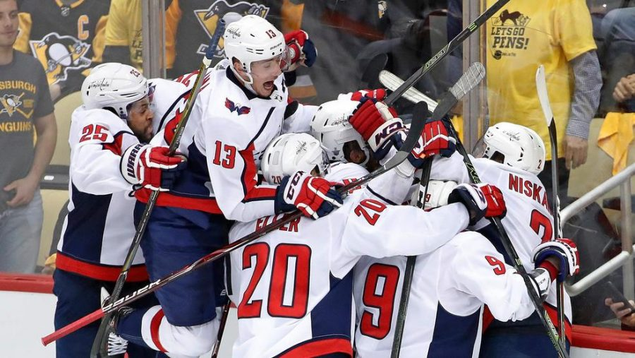 The Caps celebrate after defeating the Penguins  in Game 6 of the Conference Semifinals.