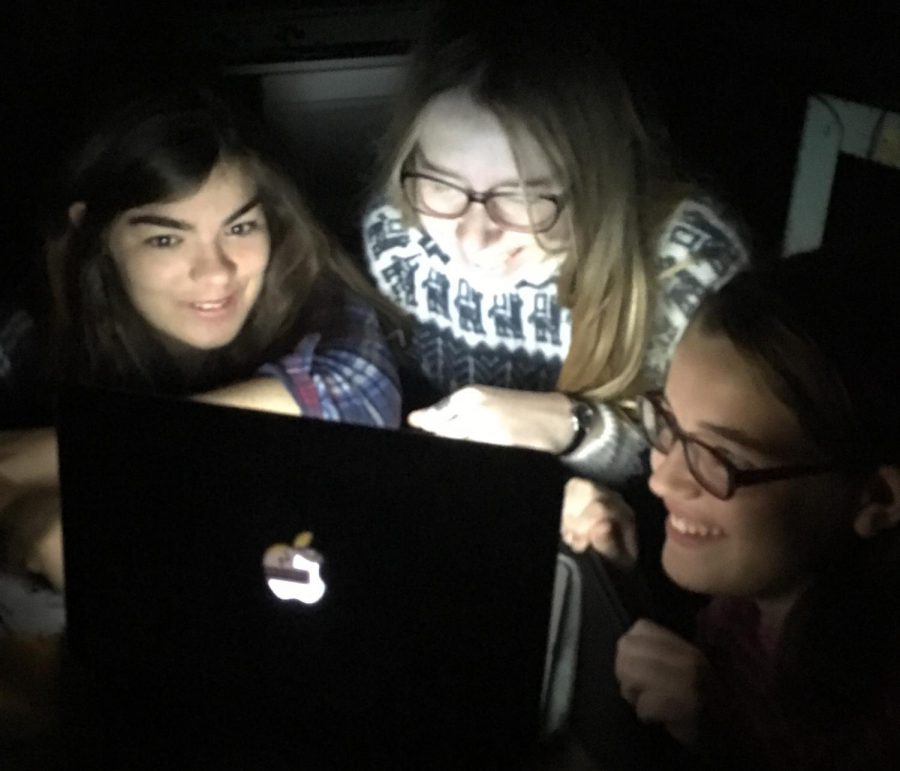 Students huddle around a computer screen to get their horror fix before Halloween. Teenagers have long been a key demographic of horror movie watchers.