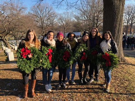 Action team members stand proudly in front of the Arlington National Cemetery, just after laying wreaths on the gravestones. Action Team hopes to complete many more service activities for future holiday seasons.