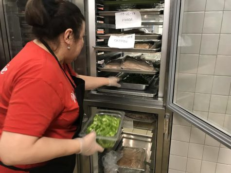 Ms. Nampha retrieves fresh peppers from one the many refrigerators in the cafeteria to prepare a sandwich for the students of Washington-Lee.