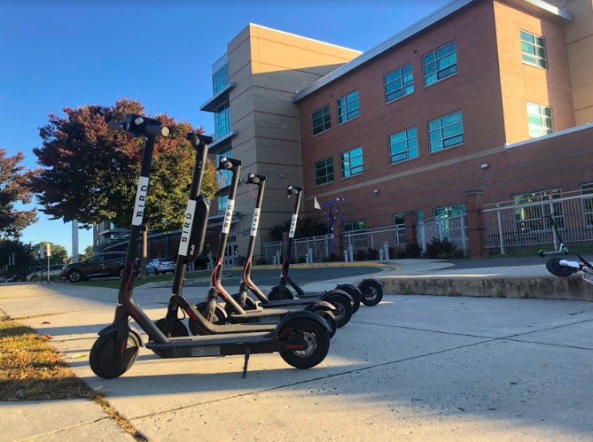 A collection of Bird scooters reside outside of the school, dropped off by students after the morning bell. Many of the students at the school use the scooters as a ride to school and back home everyday.