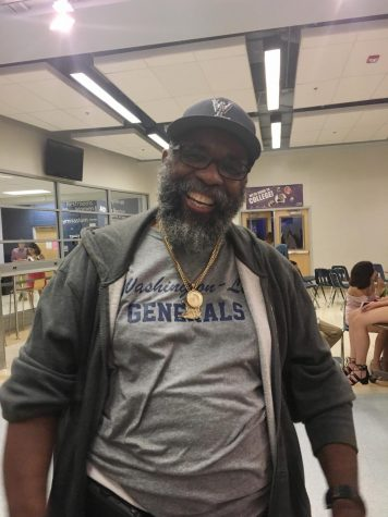 Mr. Glenroy joining in the fun at the Homecoming Dance of 2018. Though he works all day at the school, he still finds time to help out the students after school hours.
