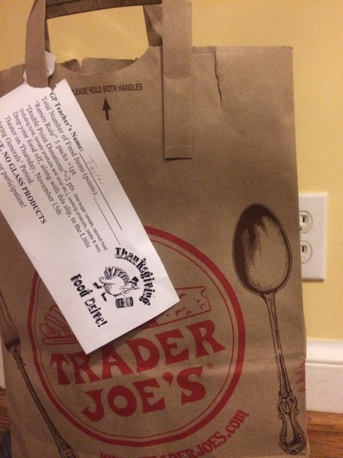 One of the bags for the food drive provided by the Student Council Association (SCA). Each bag has a slip of paper on the front, telling people the number of points they can get for donating different things.
