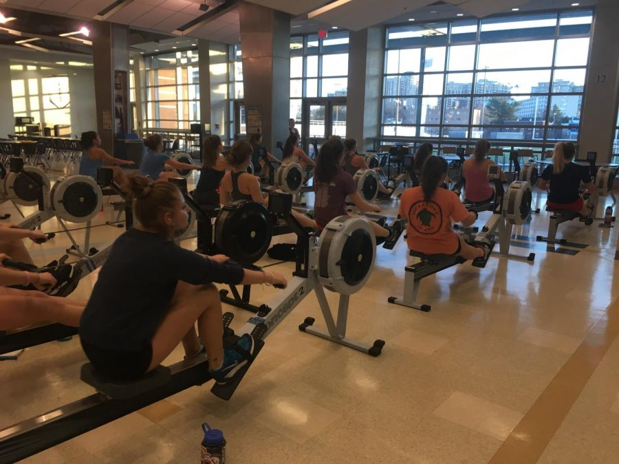 Hard+at+work%2C+the+girls+crew+team+practices+rowing+on+machines+called+ergometers.+The+crew+team+must+raise+close+to+700+dollars+per+person+in+funds.