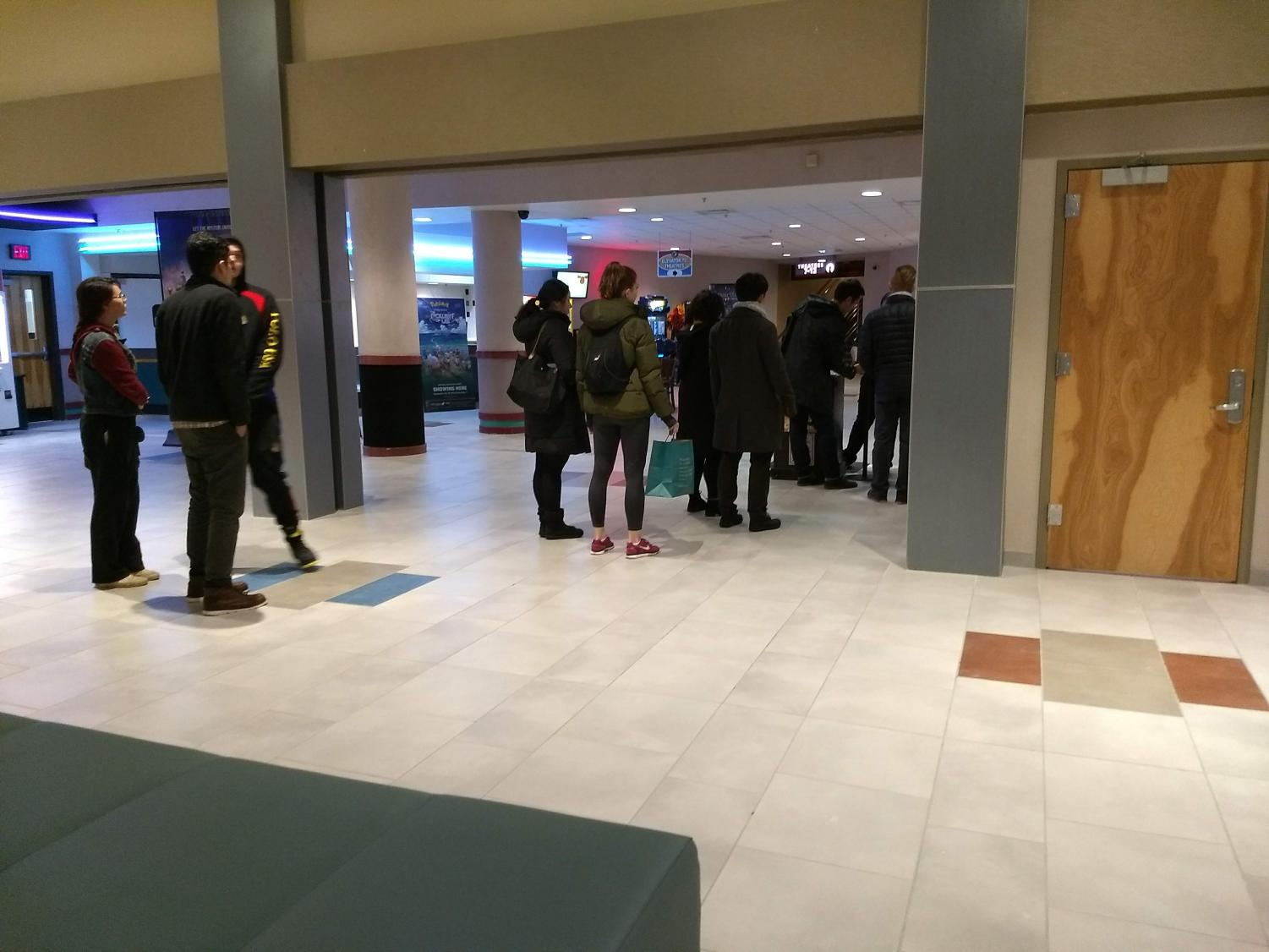 People wait in line at Ballston Mall to see what is new in theaters. The Grinch made approximately $66 million during the first weekend of its release.