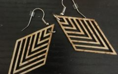 Earrings that a student bought from the fundraiser. They are handmade and one of eight different unique styles.