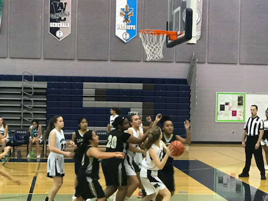 The girls freshman basketball team came into this game with a 1-1 record. The girls freshman basketball team attacked the opposition's hoop late in the second quarter.