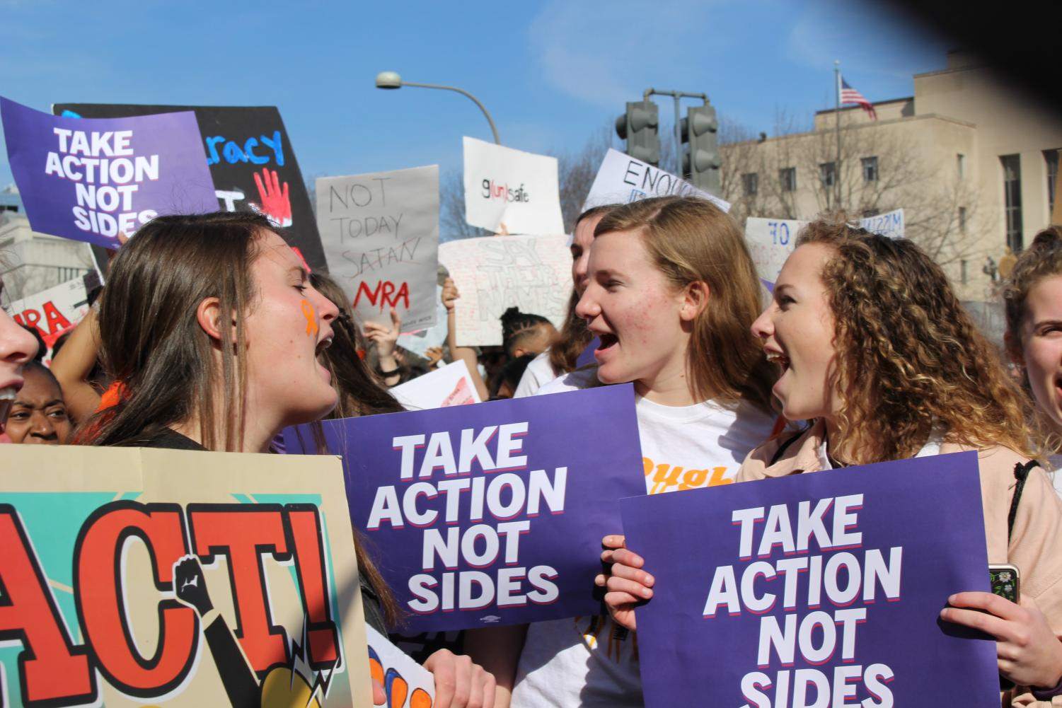 Juniors Darsey Trudo, Edie Lamantia and Ellie Lamantia shout during 2019's walkout against gun violence and march down Pennsylvania Avenue. Trudo was one of four juniors who planned the school's participation in the walkout.