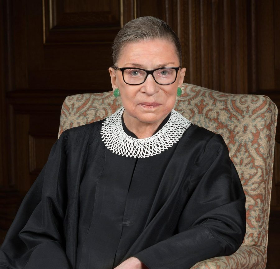 Supreme Court Justice Ruth Bader Ginsburg wearing her favorite collar. She often wears her collars to express her views and has different ones for majority and dissenting opinion.