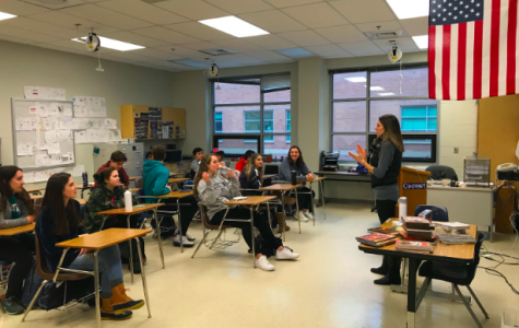 Ms. Larsen greeting her second period International Baccalaureate English Language and Literature class.