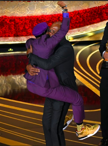 Spike Lee pounces on Samuel L. Jackson as he takes the stage to accept his award for Best Adapted Screenplay for his film BlacKkKlansman at the Dolby Theatre. Despite writing and directing many acclaimed films, this year marked Lee's first Oscar win.