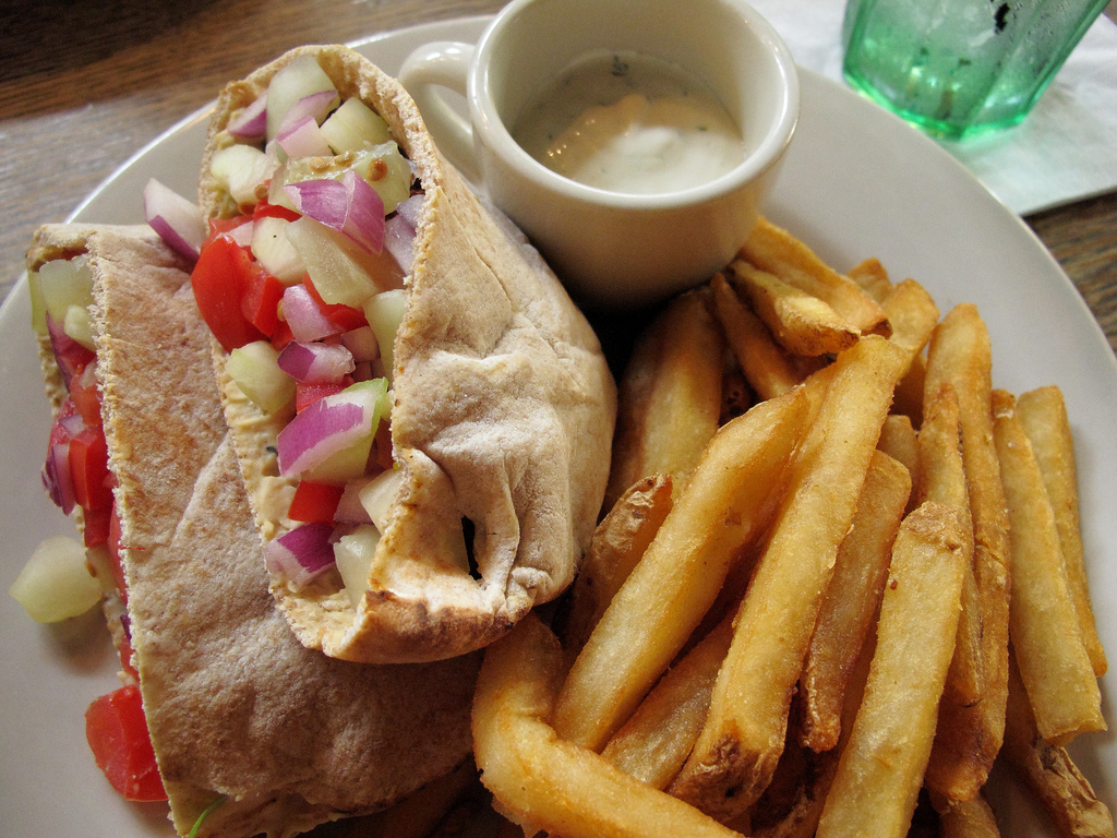 The Falafel Wrap from Busboys and Poets, a great vegetarian dish with hummus, cucumbers and tahini sauce, wrapped in a grilled tortilla. Busboys and Poets is located in Shirlington.