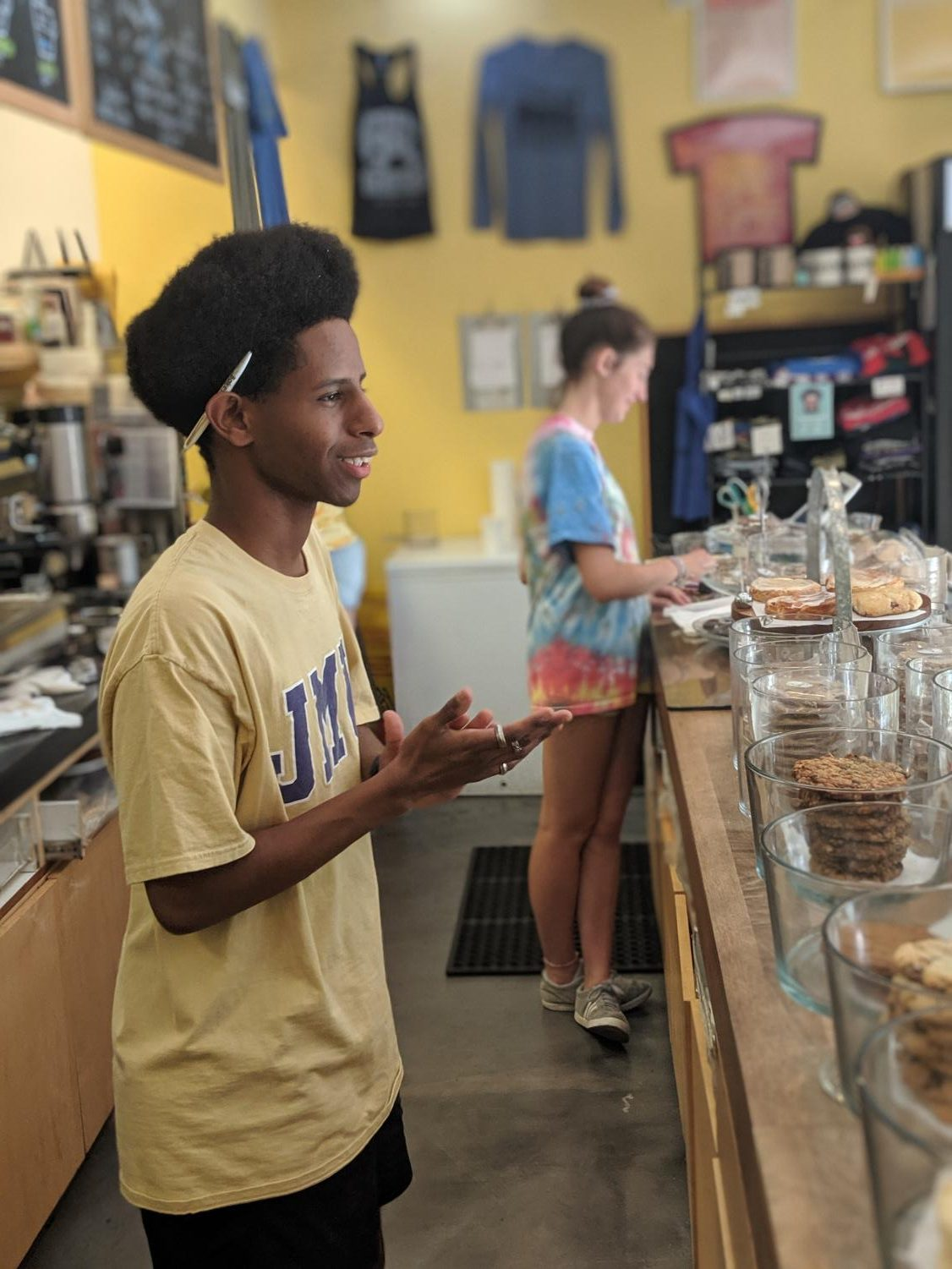 Washington-Liberty High School graduate Bemnet Negash greets one of Bakeshop's customers. Bakeshop shits usually consist of serving customers and prepping materials such as bags for use.