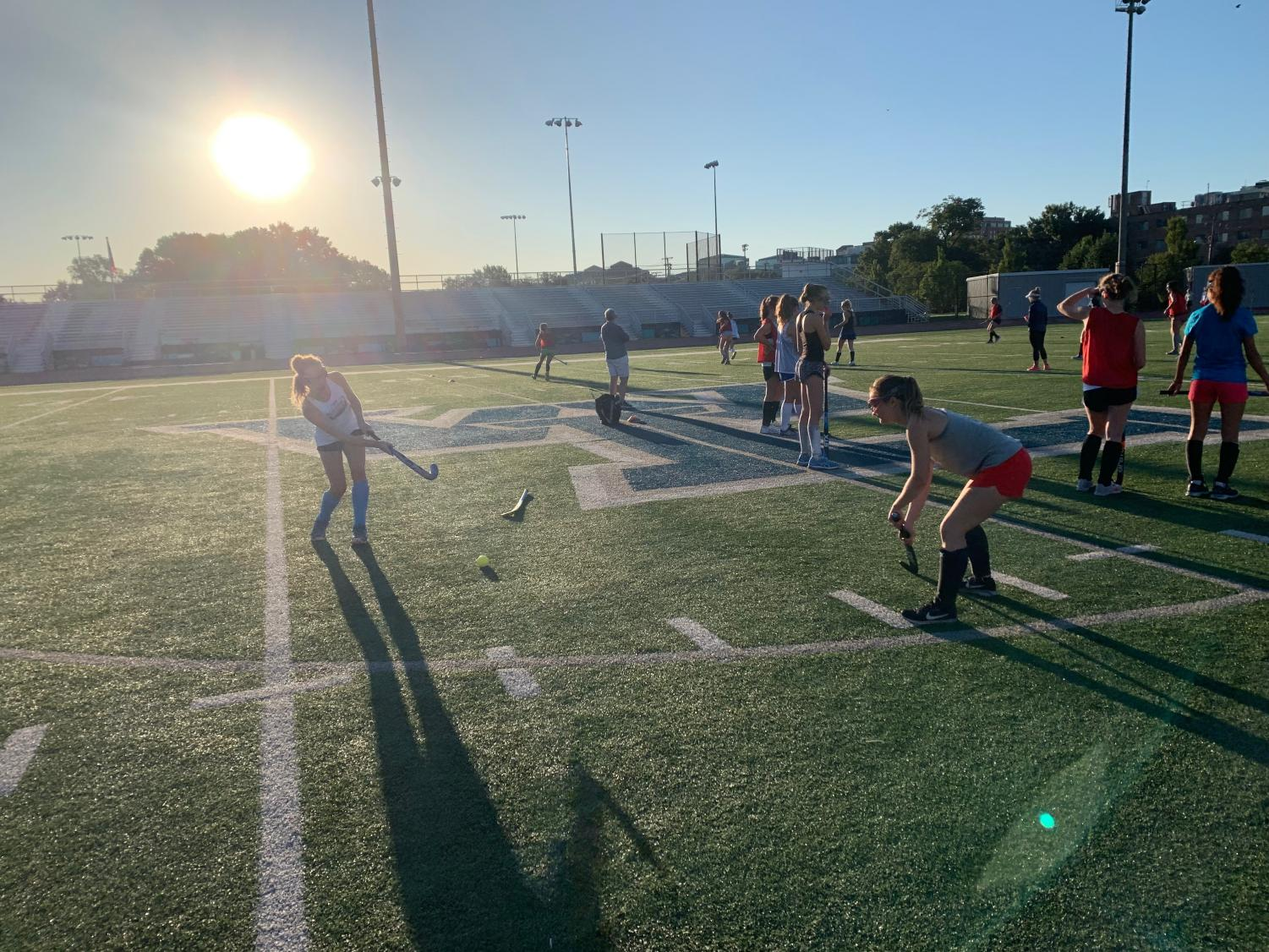 The varsity girls field hockey team prepared for the season by practicing over summer. Being on the team can be a large time commitment, even over summer, due to the amount of time that players spend practicing their skills.
